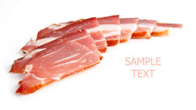 Smoked pork. Chopped pieces of smoked pork, on white background royalty free stock photography