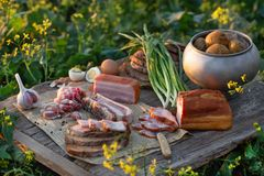 Smoked pork belly with boiled potatoes royalty free stock photo