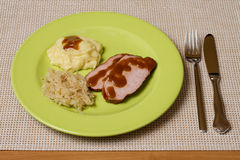 Smoked Pork chop. With Sauerkraut and Potato puree Royalty Free Stock Images