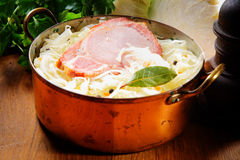 Smoked Pork Chop on Vegetable Salad Inside a Pot Royalty Free Stock Photo