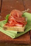 Smoked pork ham on wooden board Stock Photo