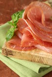 Smoked pork ham on wooden board Royalty Free Stock Photography