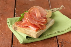 Smoked pork ham on wooden board Royalty Free Stock Images