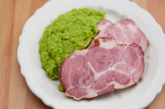 Smoked pork meat with mashed peas Stock Image