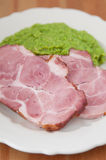 Smoked pork meat with mashed peas Royalty Free Stock Photos