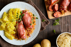 Smoked pork neck slices stuffed with sour cabbage and sausage Royalty Free Stock Photo