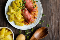 Smoked pork neck slices stuffed with sour cabbage and sausage royalty free stock image