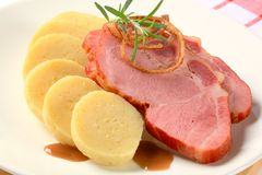 Smoked pork with potato dumplings Royalty Free Stock Photo
