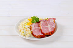 Smoked pork with potato salad Royalty Free Stock Images