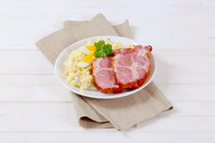 Smoked pork with potato salad Stock Image