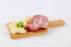 Smoked pork with potato salad Stock Photography