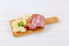 Smoked pork with potato salad Stock Photos