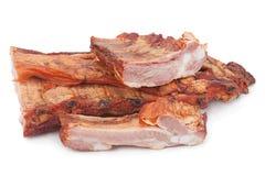 Smoked pork ribs on white Stock Photos