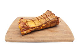 Smoked pork ribs on a wooden cutting board on white background. Horizontal photo Royalty Free Stock Image