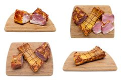 Smoked pork ribs on a wooden cutting board on white background. Horizontal photo Royalty Free Stock Photography