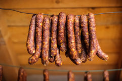 Smoked pork sausages. Placed on wire mesh for draining Stock Photo