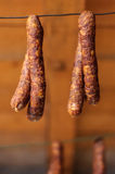 Smoked pork sausages. Placed on wire mesh for draining Stock Image
