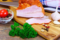 Smoked Pork with Spices on Wooden Cutting Board. Studio Photo Royalty Free Stock Photos