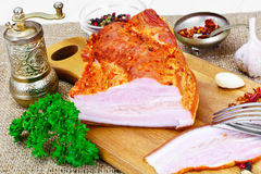 Smoked Pork with Spices on Wooden Cutting Board. Studio Photo Royalty Free Stock Photography