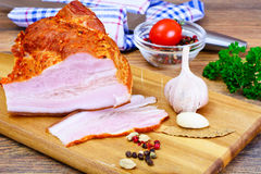 Smoked Pork with Spices on Wooden Cutting Board. Studio Photo Stock Photo
