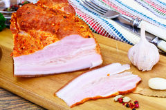 Smoked Pork with Spices on Wooden Cutting Board. Studio Photo Royalty Free Stock Photo