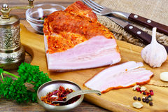 Smoked Pork with Spices on Wooden Cutting Board. Studio Photo Royalty Free Stock Images