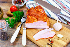 Smoked Pork with Spices on Wooden Cutting Board. Studio Photo Royalty Free Stock Image