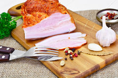 Smoked Pork with Spices on Wooden Cutting Board. Studio Photo Stock Image
