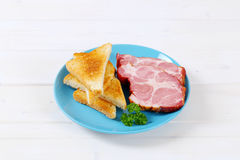 Smoked pork with toasts Stock Images