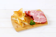 Smoked pork with toasts Royalty Free Stock Images