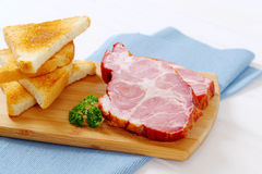 Smoked pork with toasts Royalty Free Stock Photography