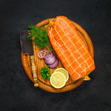 Smoked Red Fish with Lemon and Cooking Ingredients. Smoked Red Fish with Cooking Ingredients and Herbs in Top View Royalty Free Stock Image