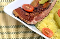 Smoked rib with mashed potato. And vegetables Stock Photography