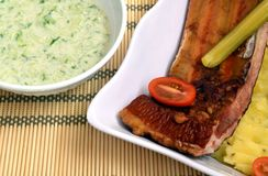 Smoked rib with potato and cucumber salad. Smoked rib with mashed potato and cucumber salad lunch Stock Images