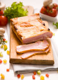 Smoked ribs. Smoked rib slices on a wooden cutting board Stock Images