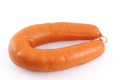 Smoked ring sausage. Stock Photography
