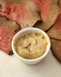 Smoked roastbeef. Served with slices of bowl of horseradish sauce Stock Photo