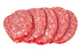 Smoked salami sausage. Sliced smoked sausage salami isolated on white background. Stock Photos