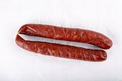 Smoked salami sausage on white royalty free stock photo