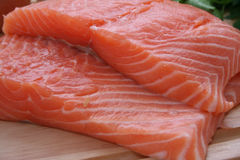 Smoked salmon. Two large slices of smoked salmon stock image
