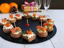 Smoked salmon appetizer bites with cream cheese royalty free stock photo