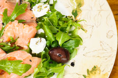 Smoked salmon with  arugula salad Royalty Free Stock Photo