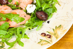 Smoked salmon with  arugula salad Royalty Free Stock Photography