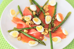 Smoked salmon with asparagus and quail eggs Stock Image