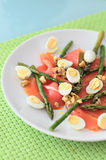 Smoked salmon with asparagus and quail eggs Stock Photos