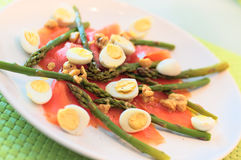 Smoked salmon with asparagus and quail eggs Royalty Free Stock Photos