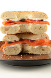 Smoked salmon on bagel. Smoked salmon or lox with cream cheese, red onion and capers on poppy seed and sesame seed bagel in vertical format Stock Photography