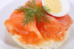 Smoked salmon on bagel with fresh black pepper. Stock Image