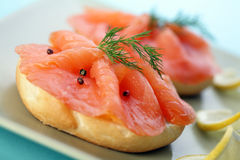 Smoked salmon on bagel with fresh black pepper. Stock Photos