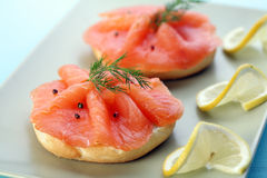 Smoked salmon on bagel with fresh black pepper. Stock Images